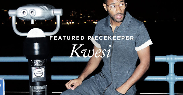 kwesi-k-featured-piecekeeper-wearing-keep-jumpsuit-black-blue-melange-onepiece